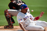 7 March 2009: #21 Miguel Olivio is safe at the plate during the 2009 World Baseball Classic Pool D match at Hiram Bithorn Stadium in San Juan, Puerto Rico. Netherlands pulled off a huge upset in their World Baseball Classic opener with a 3-2 victory over Dominican Republic.