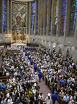 Grads march in  during the East Catholic High School graduation at the Cathedral of St. Joseph's in Hartford, Thursday, June 6, 2013. (Jim Michaud / Journal Inquirer)