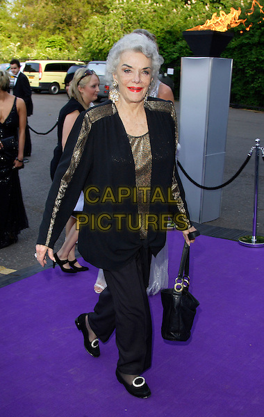 """JANE RUSSELL.Caudwell Childrens Charity's """"Legends Ball"""" held at the Battersea Evolution,, London - .May 8th 2008.full length black trousers top gold bag purse .CAP/ROS.©Steve Ross/Capital Pictures."""