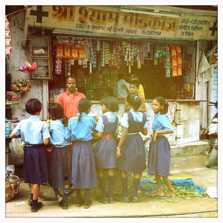 School girls in India buying fruit.