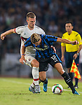 Samuele Longo of FC Internazionale Milano (L) competes for the ball with Rodrigo Ely of AC Milan during the AC Milan vs FC Internacionale as part of the International Champions Cup 2015 at the looks onnggang Stadium on July 25, 2015 in Shenzhen, China.  Photo by Aitor Alcalde / Power Sport Images