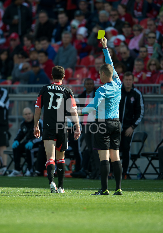 05 May 2012: D.C. United midfielder/forward Chris Pontius #13 receives a yellow card from referee Mark Kadlecik during an MLS game between DC United and Toronto FC at BMO Field in Toronto..D.C. United won 2-0.