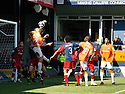 Michael Ingham of York City punches clear under pressure from Tom Craddock of Luton during the Blue Square Premier play-off semi-final 2nd leg  match between Luton Town and York City at Kenilworth Road, Luton on Monday 3rd May, 2010..© Kevin Coleman 2010 ..