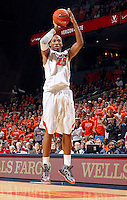 Virginia forward Akil Mitchell (25) shoots the ball during the game against NC State Saturday in Charlottesville, VA. Virginia defeated NC State 58-55.