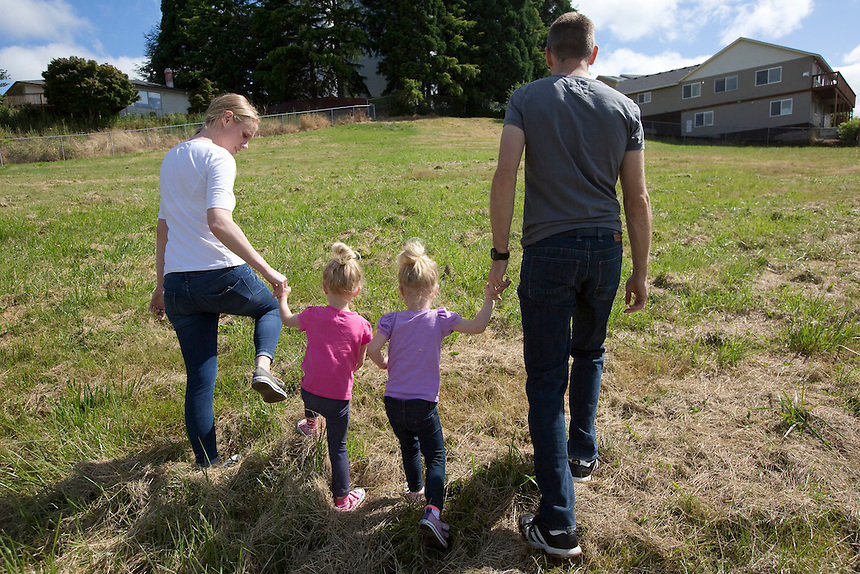 The Potter family, Kyle and Kelsey with their twin daughters Emmy (R) and Quinn at the Sorenson Neighborhood Park in Vancouver Thursday June 30, 2016. The park is one of two neighborhood parks will be built this summer to provide additional recreation within easy walking distance of nearby residents. (Photo by Natalie Behring/ The Columbian)