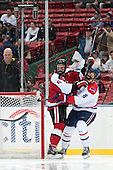 Mike Gunn (NU - 6), Evan Campbell (UML - 8) - The Northeastern University Huskies defeated the University of Massachusetts Lowell River Hawks 4-1 (EN) on Saturday, January 11, 2014, at Fenway Park in Boston, Massachusetts.