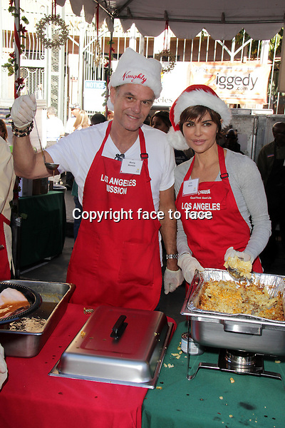 LOS ANGELES, CA - December 24: Lisa Rinna, Harry Hamlin at The Los Angeles Mission Christmas Eve Celebration, Los Angeles Mission, Los Angeles, December 24, 2013. .<br /> Credit: MediaPunch/face to face<br /> - Germany, Austria, Switzerland, Eastern Europe, Australia, UK, USA, Taiwan, Singapore, China, Malaysia, Thailand, Sweden, Estonia, Latvia and Lithuania rights only -