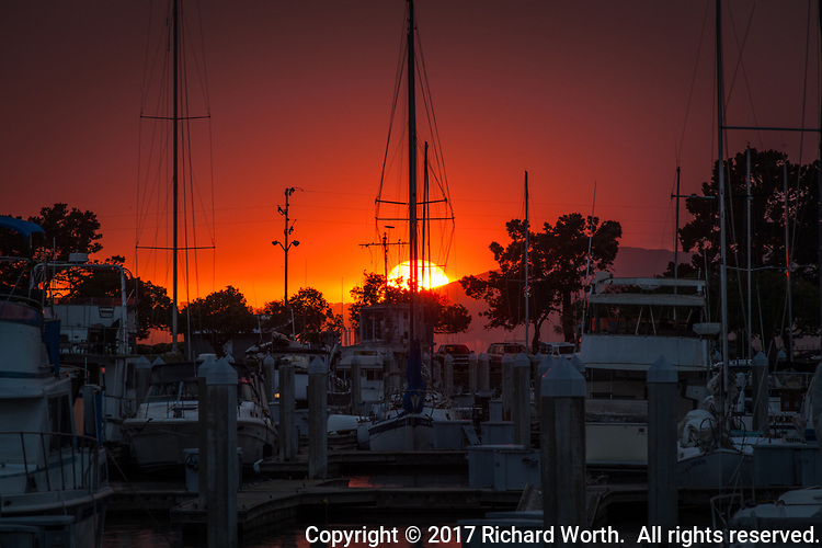 Drenched in red from California wildfires, the sun sets on October 11th 2017