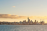 Auckland City Skyline at Sunset, North Island, New Zealand. Auckland, situated in the Hauraki Gulf of North Island is the largest and most populated city in New Zealand. With plenty to do within the city, and endless beautiful scenery on the surrounding islands and area just outside Auckland, it is easy to see why it is most people's first stop on a tour of New Zealand.