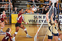 17 November 2011:  Denver middle blocker Faimie Kingsley (13) hits a kill shot in the fourth set as the FIU Golden Panthers defeated the Denver University Pioneers, 3-1 (25-21, 23-25, 25-21, 25-18), in the first round of the Sun Belt Conference Tournament at U.S Century Bank Arena in Miami, Florida.