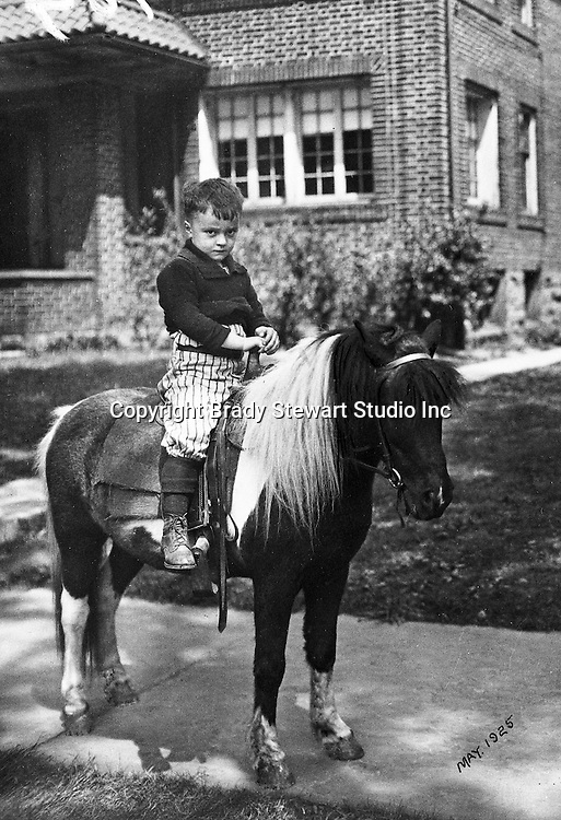 Wilkinsburg PA:  A birthday present for Brady W Stewart Jr,  a pony ride outside his house - 1925. Brady Stewart's family moved to 1007 East End Avenue in Wilkinsburg in 1925.