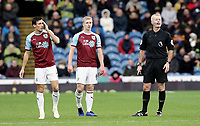 Burnley's Jack Cork (left), Ben Mee and Referee Martin Atkinson<br /> <br /> Photographer Rich Linley/CameraSport<br /> <br /> The Premier League - Burnley v Brighton and Hove Albion - Saturday 8th December 2018 - Turf Moor - Burnley<br /> <br /> World Copyright © 2018 CameraSport. All rights reserved. 43 Linden Ave. Countesthorpe. Leicester. England. LE8 5PG - Tel: +44 (0) 116 277 4147 - admin@camerasport.com - www.camerasport.com