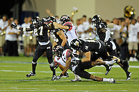 24 September 2011:  FIU tight end Colt Anderson (15) tackles ULL wide receiver Javone Lawson (4) on a kickoff return in the second quarter as the University of Louisiana-Lafayette Ragin Cajuns defeated the FIU Golden Panthers, 36-31, at FIU Stadium in Miami, Florida.