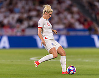 LYON,  - JULY 2: Millie Bright #6 passes the ball during a game between England and USWNT at Stade de Lyon on July 2, 2019 in Lyon, France.