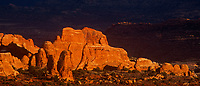 902100004 panoramic view of sunset ligth turning the sandstone formations in the fiery furnace a brilliant reddish gold in arches national park in utah