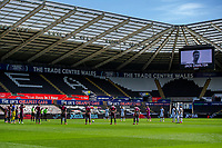 Swansea City and Leeds United players pay respect to the late Jack Charlton during the Sky Bet Championship match between Swansea City and Leeds United at the Liberty Stadium in Swansea, Wales, UK. Sunday 12 July 2020