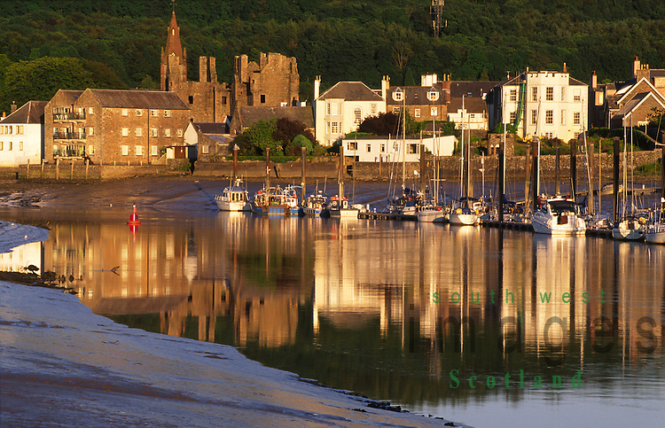 The River Dee at Kirkcudbright looking across to yachts boats at marina with MacLellan's Castle in the town behind all of which is reflected in the still waters of river Galloway Scotland UK