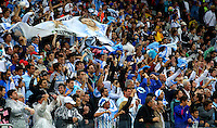 Argentina supporters cheer their side on