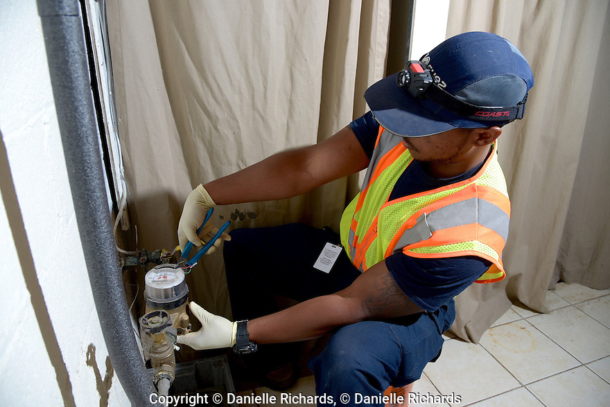 Suez employee installing new water meter in customer's home in Teaneck, NJ June 15, 2016.  The new meters use satellite and cell technology to automatically send readings to Suez.  Suez employee installing new water meter in customer's home in Teaneck, NJ June 15, 2016.  The new meters use satellite and cell technology to automatically send readings to Suez.