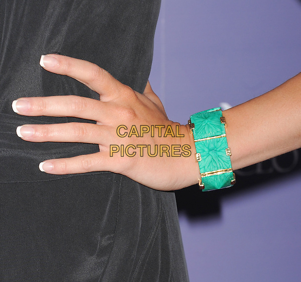 Peta Murgatroyd's hand .arriving at the 8th Annual Australians In Film Breakthrough Awards & Benefit Dinner at InterContinental Hotel in Century City, California, USA,.June 27th 2012. .detail green stone bracelet .CAP/ROT/TM.©TM/Roth Stock/Capital Pictures