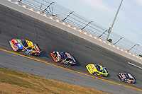 12 February  2009, Daytona Beach, Florida USA.Kyle Busch (18), Denny Hamlin (11), Mark Martin (5) and Brian Vickers race for the lead..Daytona International Speedway: Gatorade Duels Qualifying Race(s).©F.Peirce Williams 2009.F. Peirce Williams.photography