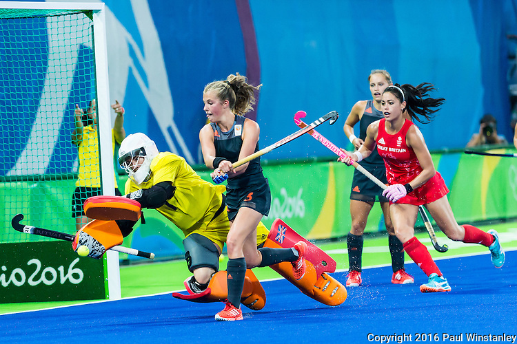 Xan de Waard #3 of Netherlands prepares to shoot while Maddie Hinch #1 of Great Britain scrambles to cover during Netherlands vs Great Britain in the gold medal final at the Rio 2016 Olympics at the Olympic Hockey Centre in Rio de Janeiro, Brazil.