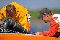 "Sean Bowsher Y-52 works on his boat as rival Dan Kanfoush, Y-1 ""Fast Eddie Too"" looks on and offers unwanted advice.  (1 Litre MOD hydroplane(s)"