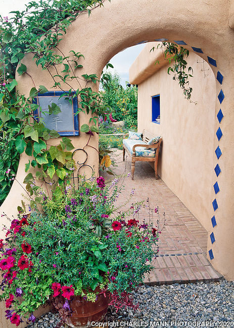 Susan Blevins of Taos, New Mexico, created an elaborate home garden featuring containers, perennial beds, a Japanese themed path and a regional style that reflects the Spanish and pueblo architecture of the area. A stucco portal lined with vines adds a mystical air.