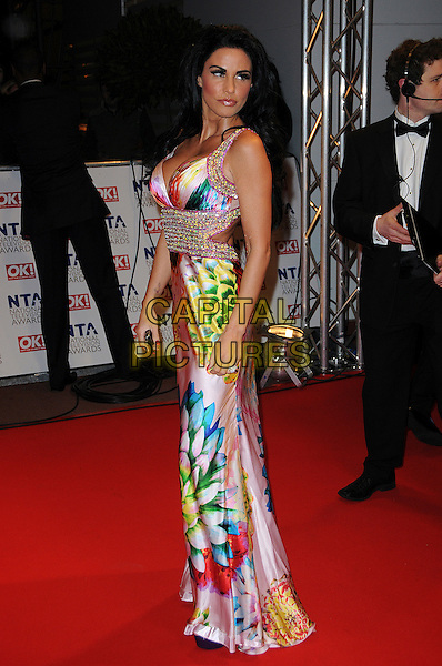JORDAN - KATIE PRICE .-.The 15th National Television Awards held at the O2 Arena, London, England..January 20th, 2010.NTA NTAs full length white pink green yellow blue floral print dress silver beads beaded .CAP/CAS.©Bob Cass/Capital Pictures.