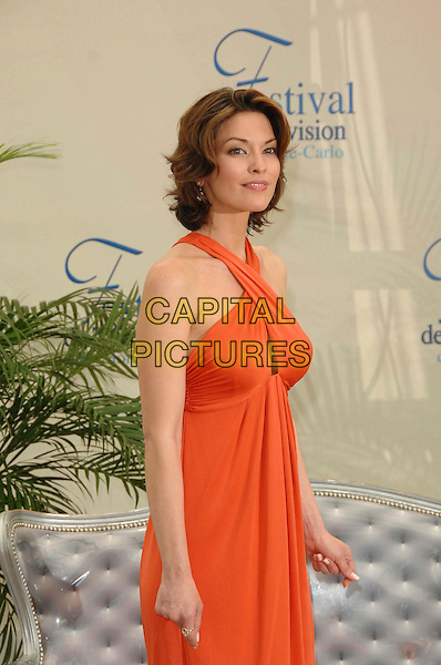 "ALANA DE LA GARZA.Photocall promoting the television series ""Law And Order"" during the fourth day of the 2008 Monte Carlo Television Festival held at Grimaldi Forum, Monaco, Principality of Monaco,.June 11th, 2008..half length red orange dress halterneck .CAP/TTL .©TTL/Capital Pictures"