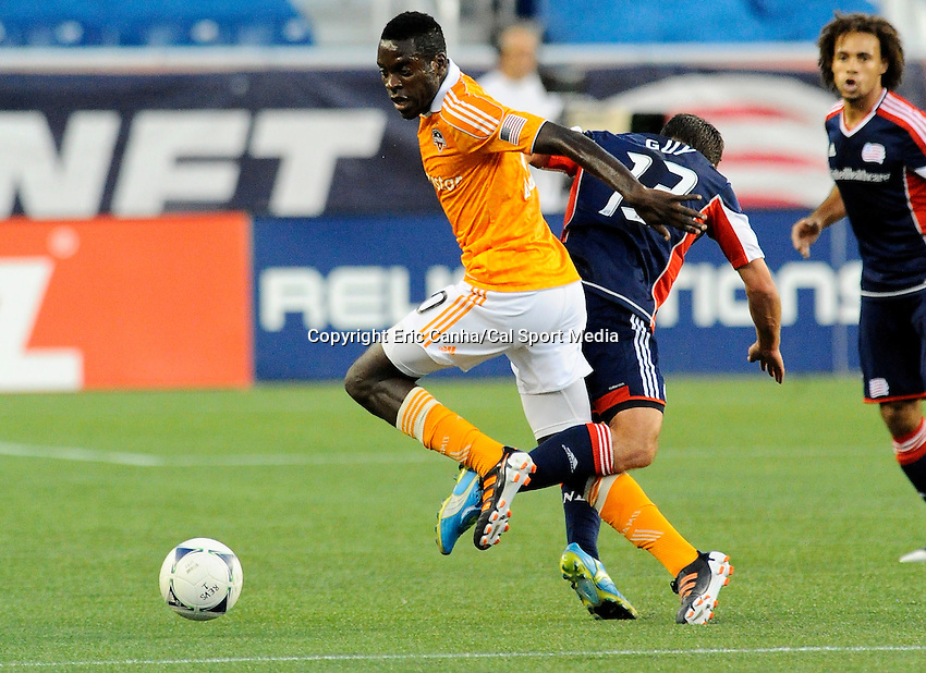 MAY 19 2012 Houston Dynamo midfielder Je-Vaughn Watson #10 and New England Revolution midfielder Ryan Guy #13 get tangled up makng a play for the ball Saturday...