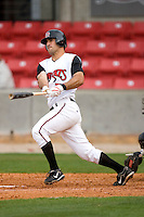 Chris Denove #7 of the Carolina Mudcats follows through on his swing versus the Jacksonville Suns at Five County Stadium May 18, 2009 in Zebulon, North Carolina. (Photo by Brian Westerholt / Four Seam Images)