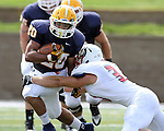 SIOUX FALLS, SD - SEPTEMBER 7:  Dajon Newell #20 from Augustana looks to shake the grasp of Chris Lee #33 from Minnesota State University Moorhead in the first quarter of their game Saturday at Augustana. (Photo by Dave Eggen/Inertia)