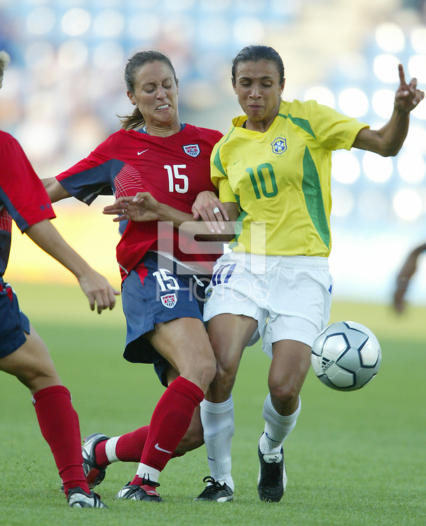 14 August 2004:   USA Kate Markgraf fights for the ball against Marta from Brazil at Kaftanzoglio Stadium in Thessaloniki, Greece.   USA defeated Brazil, 2-0. Credit: Michael Pimentel / ISI