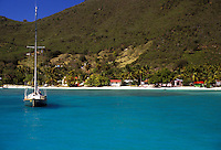 AJ2369, British Virgin Islands, Jost Van Dyke, Caribbean, Virgin Islands, B.V.I., BVI, Sailboat buoyed on the calm blue green waters of Great Harbor on the island of Jost Van Dyke on the British Virgin Islands.