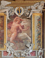 The abduction of Philyra by Saturn as a white horse, fresco by Rosso Fiorentino, 1535-37, in a carved stucco frame, in the Galerie Francois I, begun 1528, the first great gallery in France and the origination of the Renaissance style in France, Chateau de Fontainebleau, France. The Palace of Fontainebleau is one of the largest French royal palaces and was begun in the early 16th century for Francois I. It was listed as a UNESCO World Heritage Site in 1981. Picture by Manuel Cohen