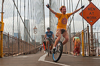 Brooklyn, NY -  3 September 2010Unicyclists cross the Brooklyn Bridge enroute to Coney Island for the 14 mile Brooklyn Long Distance Unicycle Ride.