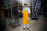 18 year old Mia Nurhikmah, high school student at Kartini Emergency School, working in the bakery of a foreign franchise supermarket where she now earns a decent wage. The 'Twin Teachers' recommended Mia to supermarket's director, and after passing some tests, she was accepted. Since the early 1990s, twin sisters Sri Rosyati (known as Rossy) and Sri Irianingsih (known as Rian) have used their family inheritance to set up and run 64 schools in different parts of Indonesia, providing primary education combined with practical skills to some of the country's most deprived children. .