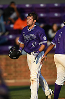 Catcher John Michael Boswell (8) of the Furman Paladins is congratulated after scoring a run in game two of a doubleheader against the Harvard Crimson on Friday, March 16, 2018, at Latham Baseball Stadium on the Furman University campus in Greenville, South Carolina. Furman won, 7-6. (Tom Priddy/Four Seam Images)