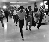 Members of the Jackson five run thru the Oakland Airport after landisng in Oakland. (1981 photo/Ron Riesterer)
