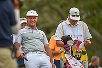 Bryson DeChambeau (USA) shares a laugh on the tee on 12 during round 3 of The Players Championship, TPC Sawgrass, at Ponte Vedra, Florida, USA. 5/12/2018.<br /> Picture: Golffile | Ken Murray<br /> <br /> <br /> All photo usage must carry mandatory copyright credit (&copy; Golffile | Ken Murray)