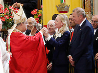 Cardinal Crescenzio Sepe, Archbishop of Naples holds a vial said to contain the blood of San Gennaro, asCamilla Cruciani  Princes of Borbone, during the San Gennaro miracle announcement in the cathedral of Naples, 19 September 2016