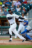 Luis Robert (9) of the Charlotte Knights follows through on his swing against the Buffalo Bisons at BB&T BallPark on July 24, 2019 in Charlotte, North Carolina. The Bisons defeated the Knights 8-4. (Brian Westerholt/Four Seam Images)