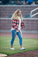 A young singer walks off the field after performing the National Anthem before a Pioneer League game between the Idaho Falls Chukars and the Billings Mustangs at Melaleuca Field on August 22, 2018 in Idaho Falls, Idaho. The Idaho Falls Chukars defeated the Billings Mustangs by a score of 5-3. (Zachary Lucy/Four Seam Images)