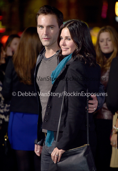 Courteney Cox and  Johnny McDaid at The Warner Bros. Pictures' Premiere of Horrible Bosses 2 held at The TCL Chinese Theatre in Hollywood, California on November 20,2014                                                                               © 2014 Hollywood Press Agency