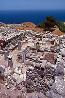 "The ruins of an ancient town -- """"Old Thira"""" or """"Old Thera""""-- lie 1200 feet above the Mediterranean Sea on the promontory of Mesa Vouno, Santorini, Greece."