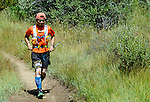 August 20, 2016 - Leadville, Colorado, U.S. -  Ultra distance runner, Hirofumi Yamamoto #835, finds his way through the willow thickets prior to ascending to Hope Pass during the Blueprint for Athletes Leadville Trail 100, Leadville, Colorado.  Considered one of the most challenging endurance races in the world, ultra distance runners will navigate high altitude trails, challenging river crossings, and a variety of changing weather with an elevation gain of more than 18,000 feet ranging from 9200 feet near Twin Lakes to 12,600 feet atop the high point of Hope Pass.
