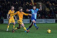 Darren Jones of Newport County clears from Paul Hayes of Wycombe Wanderers during the Sky Bet League 2 match between Newport County and Wycombe Wanderers at Rodney Parade, Newport, Wales on 22 November 2016. Photo by Mark  Hawkins.