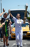 24.07.2012. London England. Chinese Former Winter Olympic Champion Yang Yang carries The Olympic Flame during The Torch Relay of The 2012 London Olympics in London