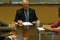 Illinois Governor Pat Quinn meets with advisers including State's Attorney Lisa Madigan (right) on his first day in office  at the Thompson Center in Chicago, Illinois on January 30, 2009.  The day before, the Illinois State Senate voted to impeach Quinn's predecessor, Rod Blagojevich.